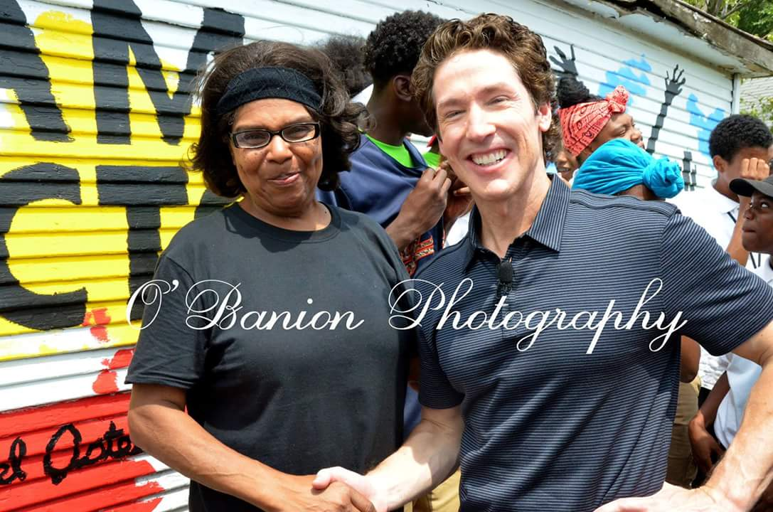 "Pastor Joel Osteen with Karen Washington, a long-time neighborhood leader who led an effort to transform a blighted alleyway into ""Bliss Lane"" with local artists, the young people at our center, and volunteers from Lakewood Church in Texas."