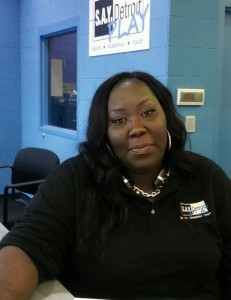 Tiara Johnson at the front desk of the SAY Detroit Play Center