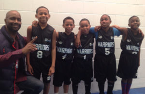 Coach Derrick Hayes, Jeremiah, Adolphus, Jeremiah, Johnathan and Omar after the team's first victory.
